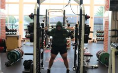 Vice-President of the Simpson College Powerlifting Club, Brennan Linn, prepares to do a back squat.